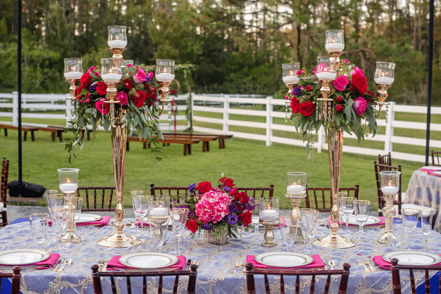 stunning wedding reception table in bold reds and purples