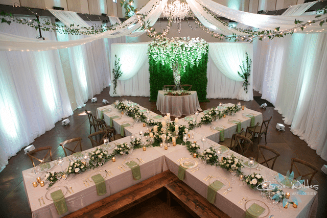 wedding reception tables arranged in X shape