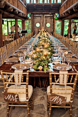gorgeous rustic reception table in barn