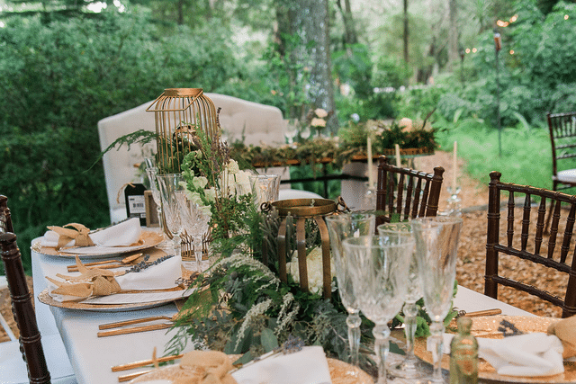 romantic, elegant wedding reception table with gold and green