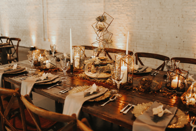 wedding reception table with geometric gold accents