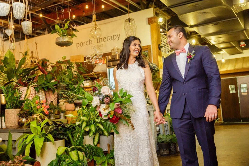 Audubon Park Exchange Ballroom - newlyweds posing by florist shop