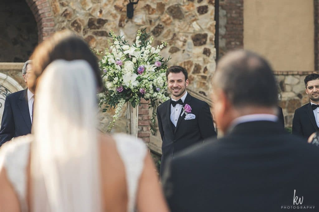 Bella Collina - groom watching bride walk down the aisle