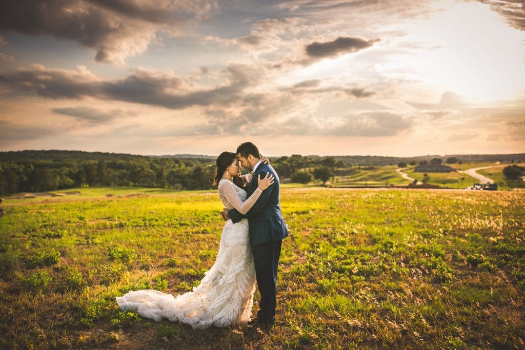 Bella Collina - bride and groom in open field