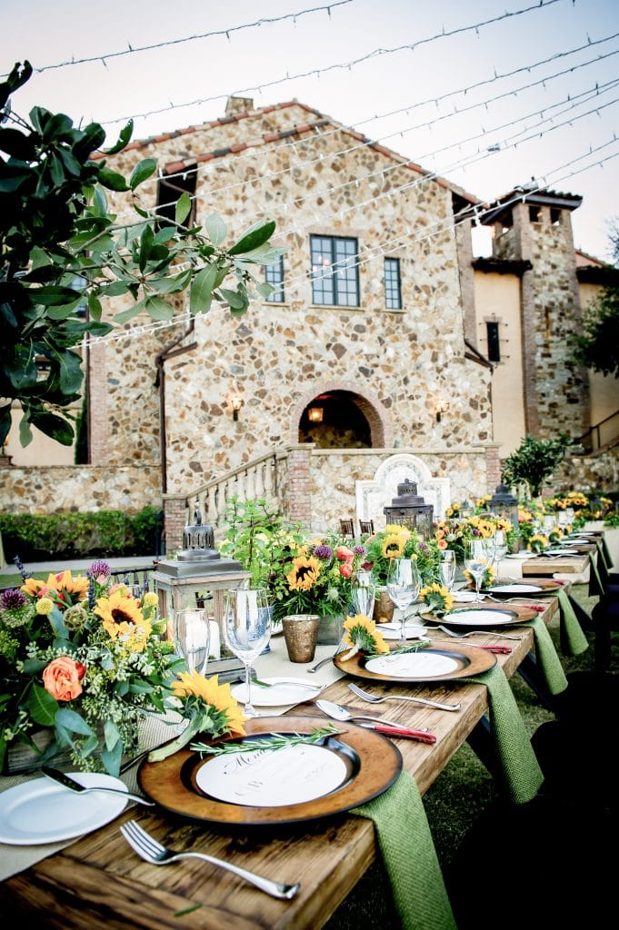 Bella Collina - outdoor reception space with stone building