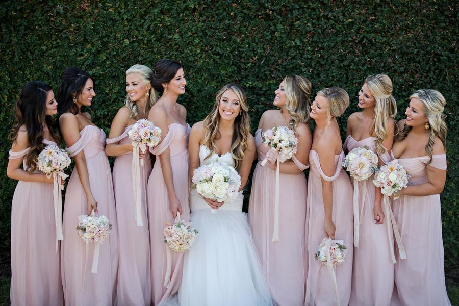 Bella Collina - bride and bridesmaids in front of vine wall