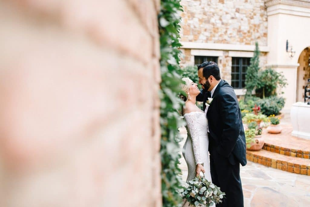 Bella Collina - bride and groom in gorgeous outdoor courtyard