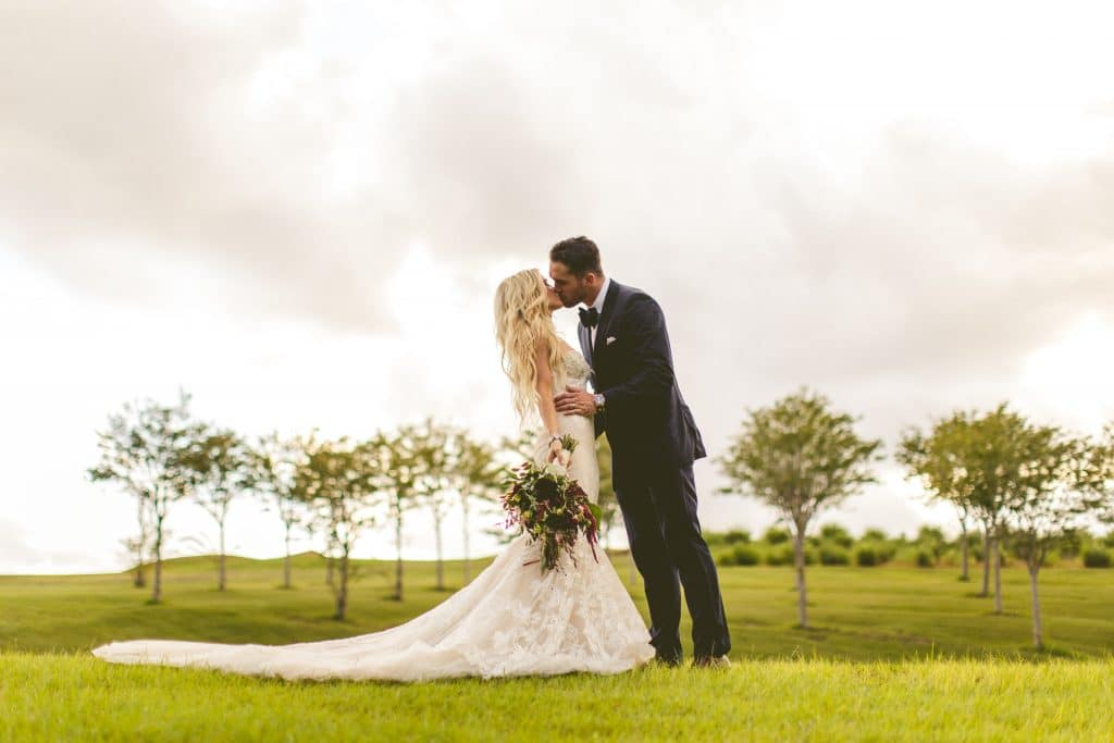 Bella Collina - bride and groom in field