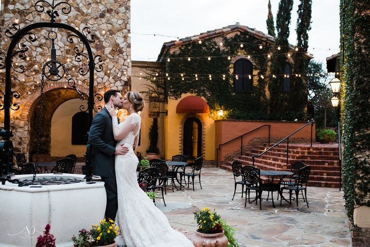 Bella Collina - bride and groom in Tuscan inspired courtyard