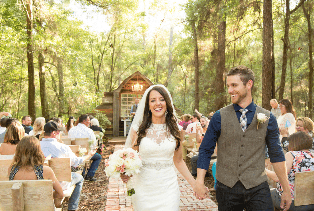 Bridle Oaks Barn - just married couple in rustic outdoor ceremony space