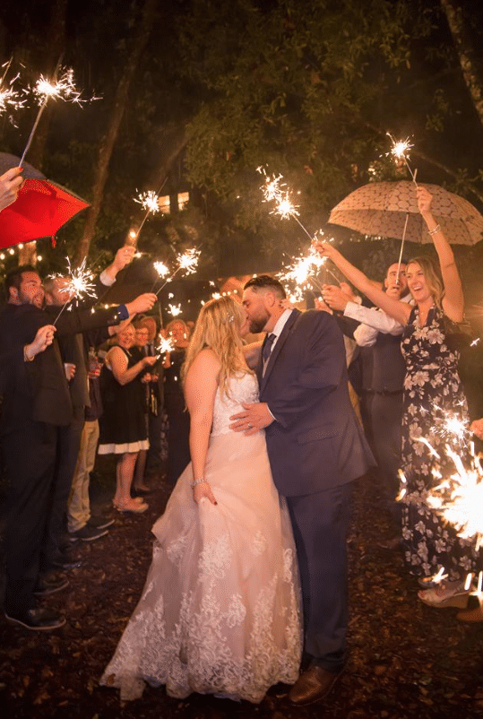 Bridle Oaks Barn - bride and groom kissing with sparkler sendoff