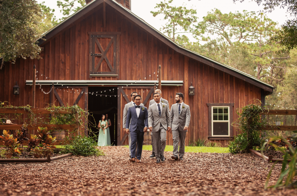 Bridle Oaks Barn - groom and groomsmen leaving barn