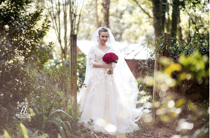 Bridle Oaks Barn - bride posing in romantic woods