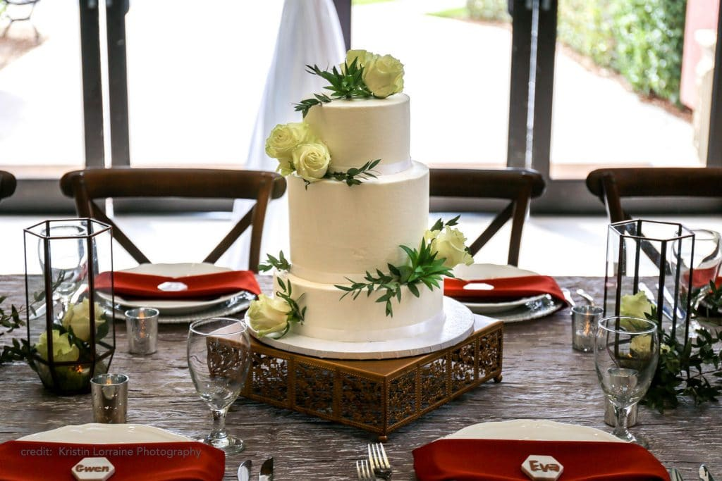 Caribe Royale - minimal white wedding cake with roses and green sprigs
