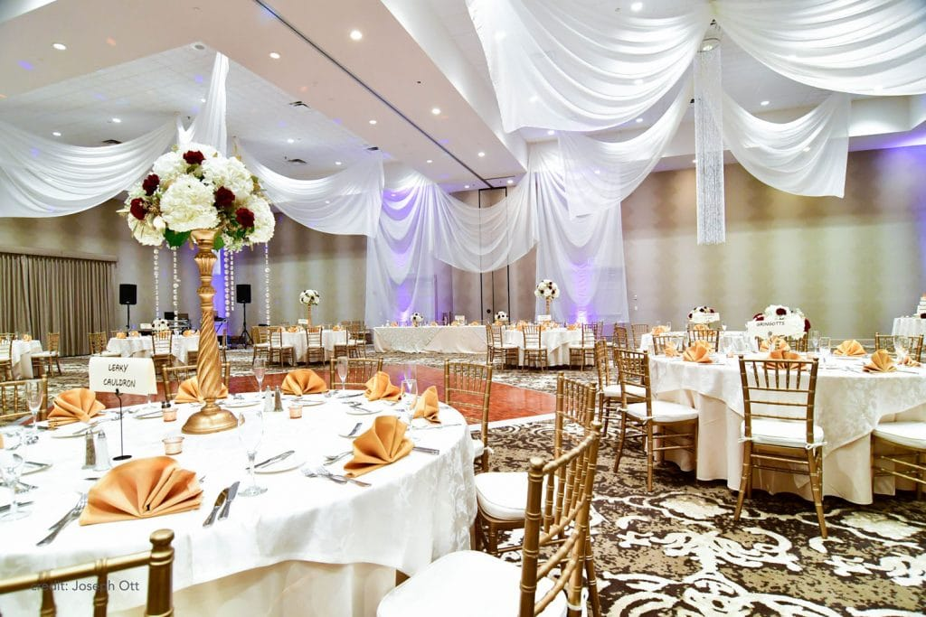 Caribe Royale - reception room in white and gold with ceiling drapery