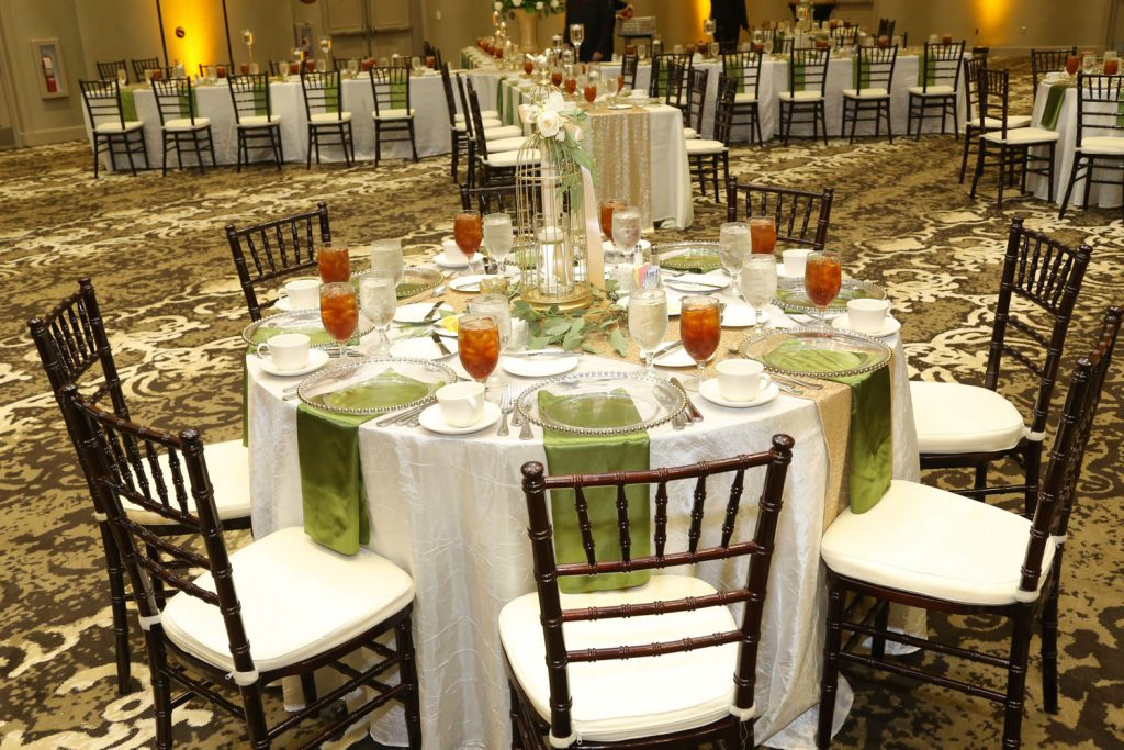 Caribe Royale - green and gold tablescape at reception