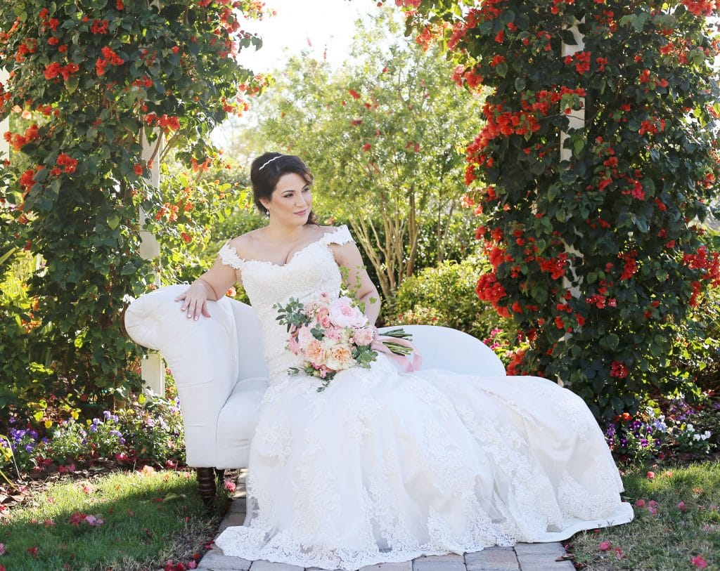 Celebration Gardens - bride lounging on outdoor chaise longue