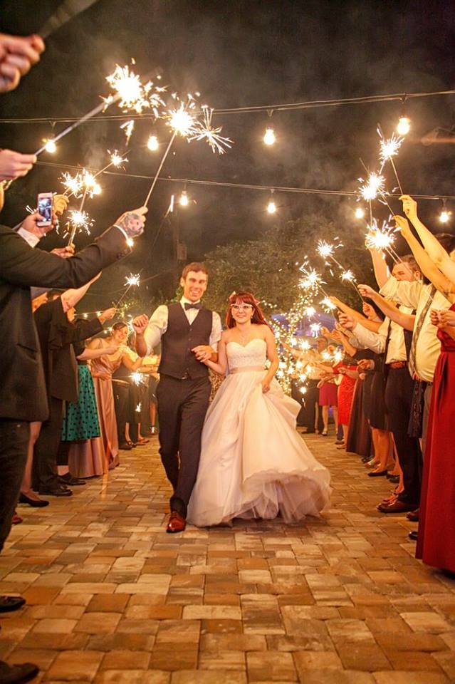 Celebration Gardens - bride and groom with sparkler send-off