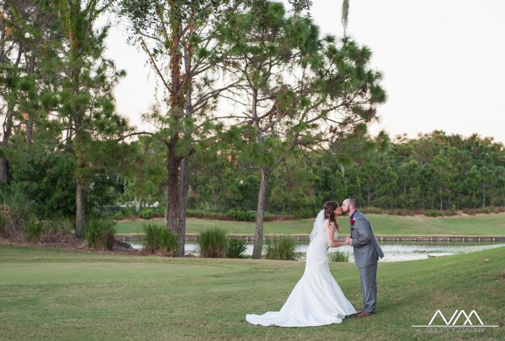 Celebration-Golf-Club-Bride and Groom kissing on golf course