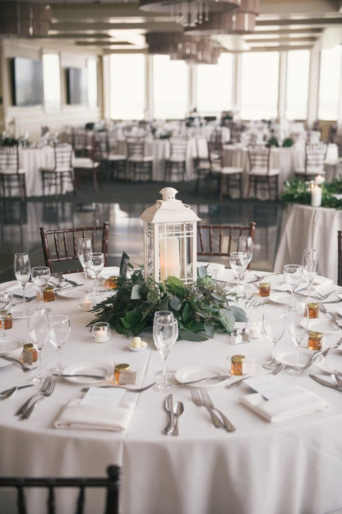 Citrus Club - all-white reception tables with greenery