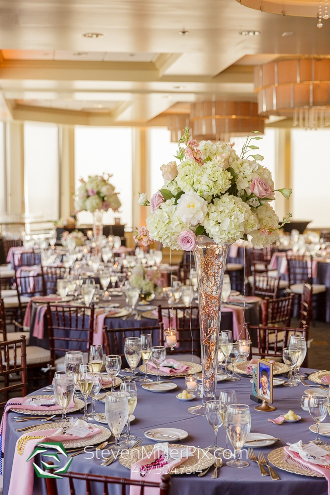 Steven Miller Photography - reception tables decorated with tall centerpieces