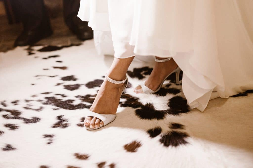 Club Lake Plantation - bride's feet on cowhide rug