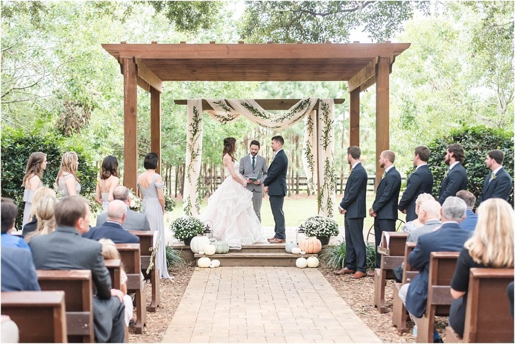 Club Lake Plantation - wedding ceremony under gorgeous outdoor pergola
