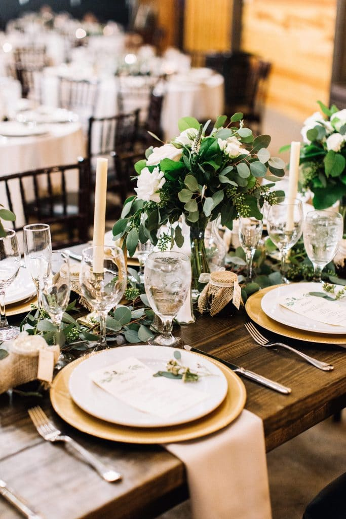 Club Lake Plantation - rustic reception table with eucalyptus arrangements