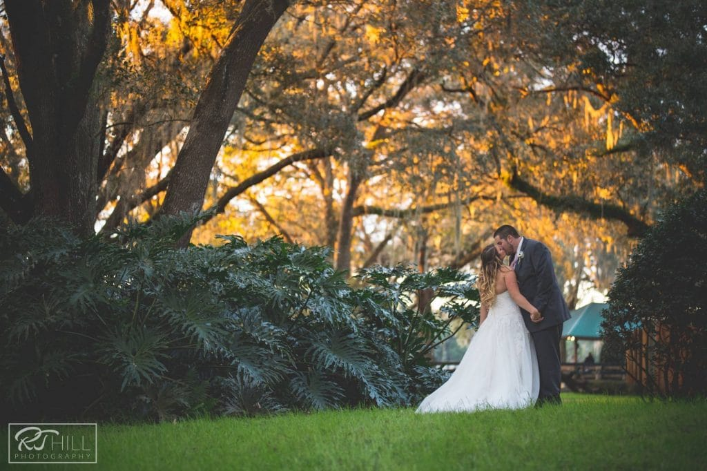 Club Lake Plantation - bride and groom kissing outdoors