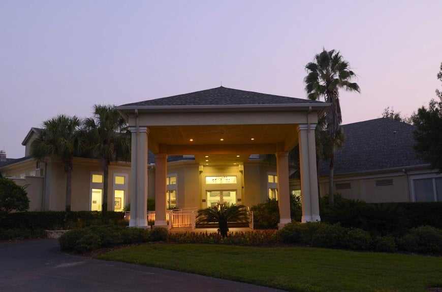 Debary-Golf-Country-Club-Entrance to the country club lit up at dusk