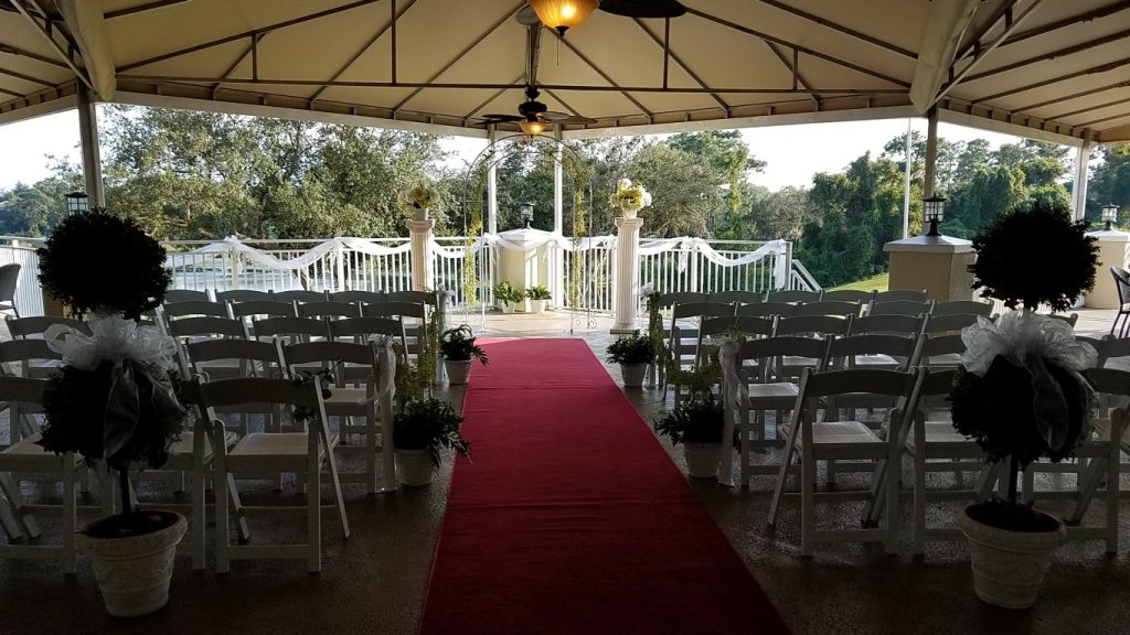 Debary-Golf-Country-Club-Outdoor pavillion wedding ceremony area with red carpet