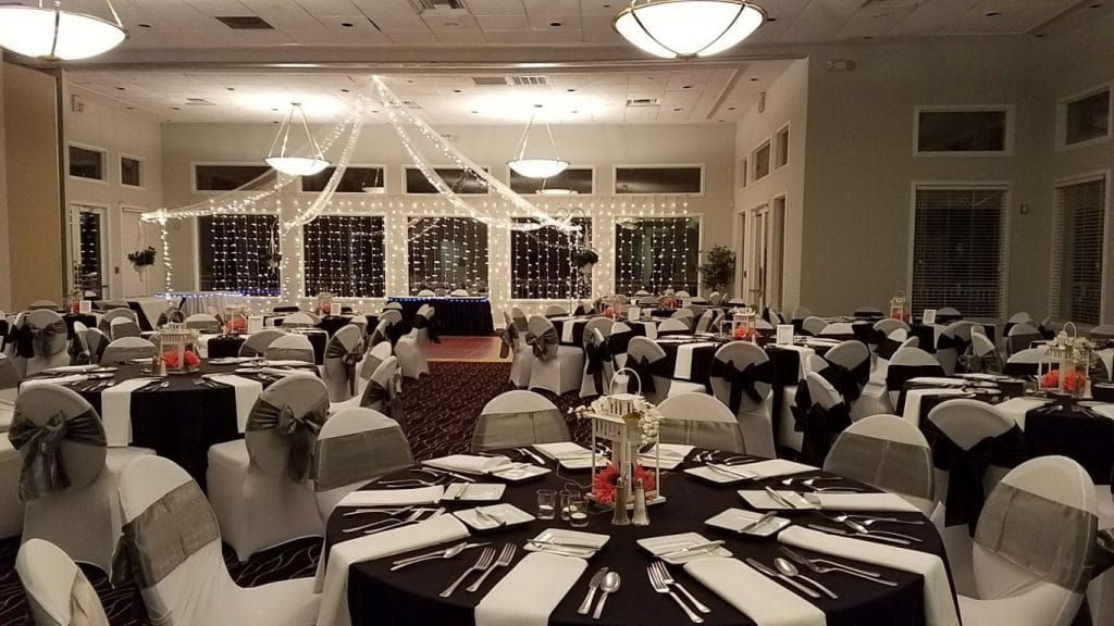 Debary-Golf-Country-Club-Indoor reception area with large round table settings