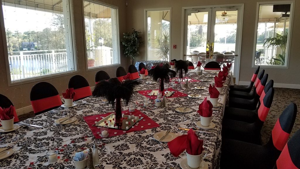 Debary-Golf-Country-Club-Long rectangular family style table dressed in black, white and red accents