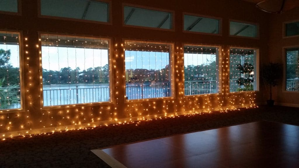 Debary-Golf-Country-Club-Large picture windows with white standed lights overlayed