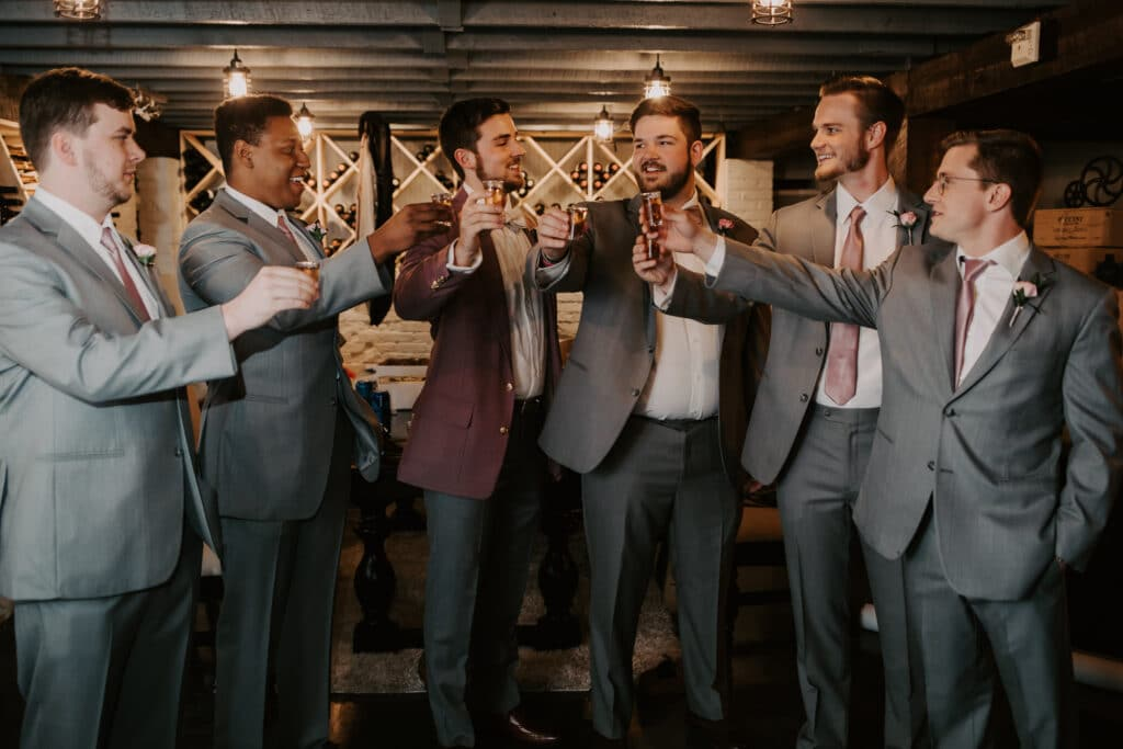 Dr Phillips House Downtown Orlando Wedding Venue groomsmen toasting the groom on his wedding day