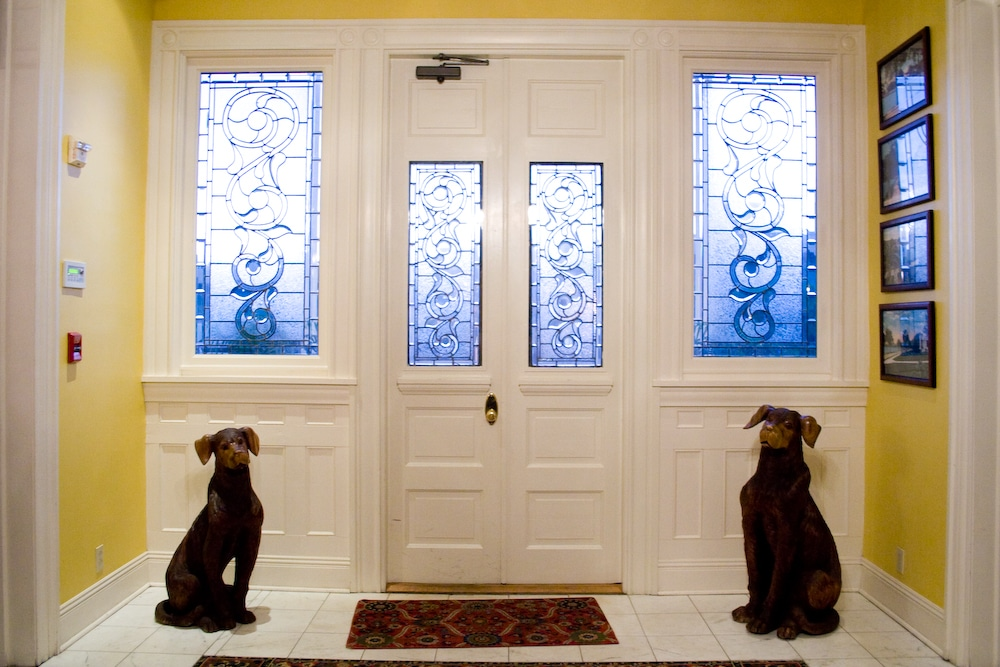 Dr Phillips House Downtown Orlando Wedding Venue front door area with two small statues of dogs standing guard