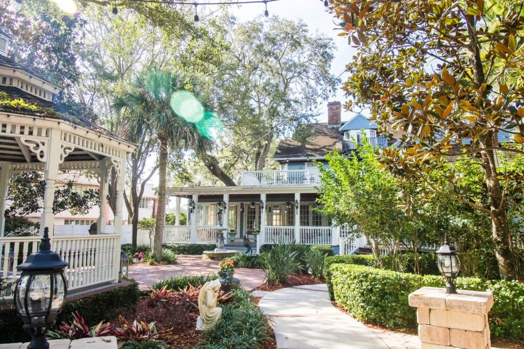 Dr Phillips House Downtown Orlando Wedding Venue outdoor garden area with house in background and gazebo to the left