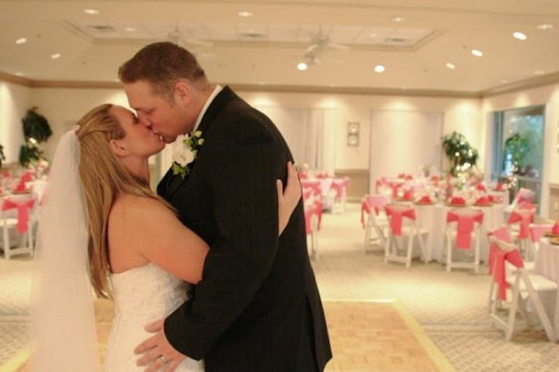 Falcon's Fire bride and groom kissing at inside reception during private look