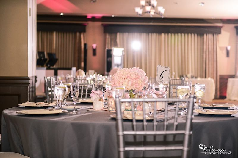 Falcon's Fire indoor wedding reception with grey tablecloth and accents