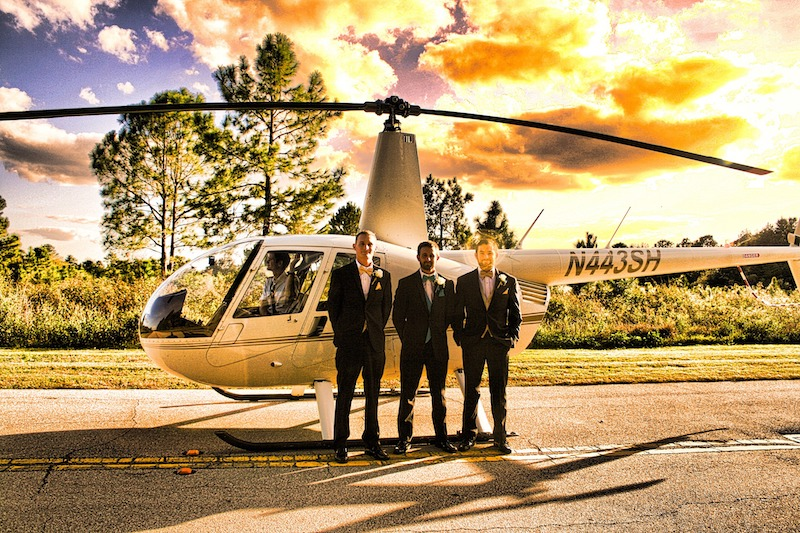Falcon's Fire groomsmen standing in front of helicopter