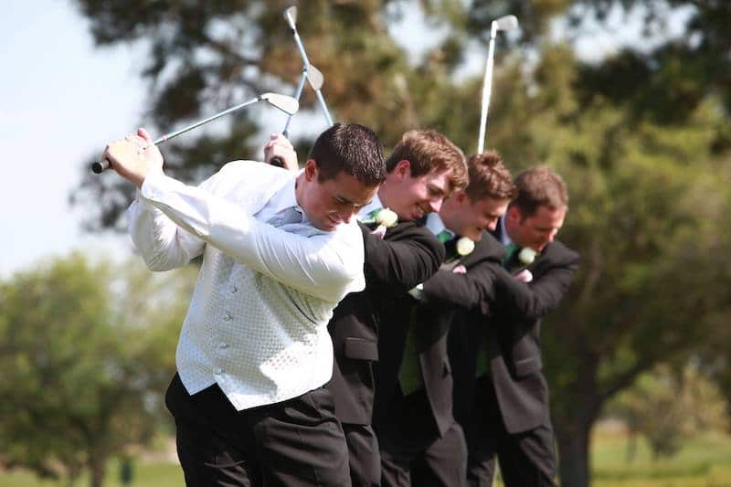 Falcon's Fire groom and groomsmen swinging golf clubs