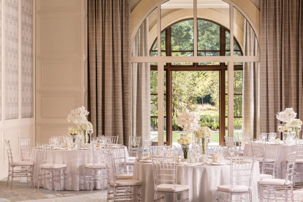 Four-Seasons-at-Walt-Disney-World-Large tables set for reception next to large open window