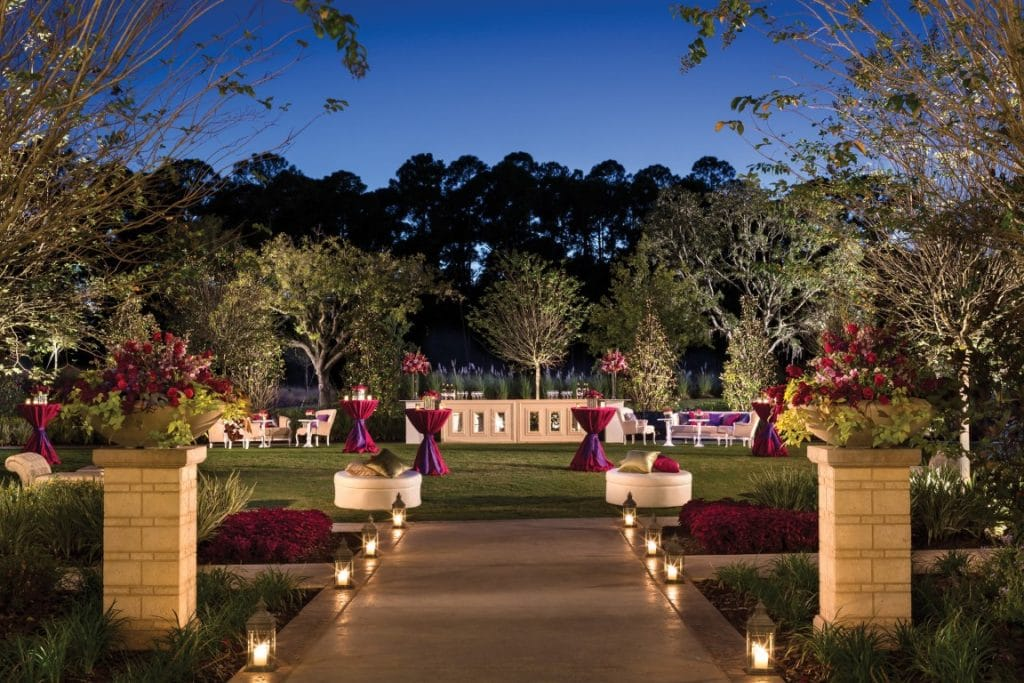 Four-Seasons-at-Walt-Disney-World-High top coctail tables set on greens for outdoor reception at dusk