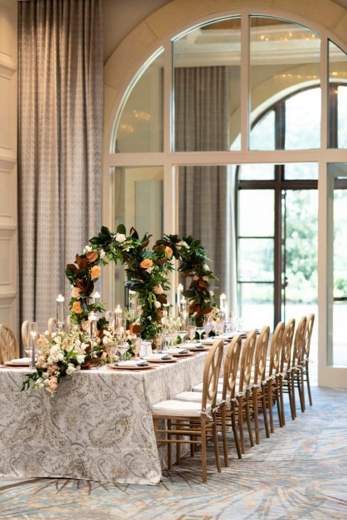 Four-Seasons-at-Walt-Disney-World-Long table with floral arches as centerpieces