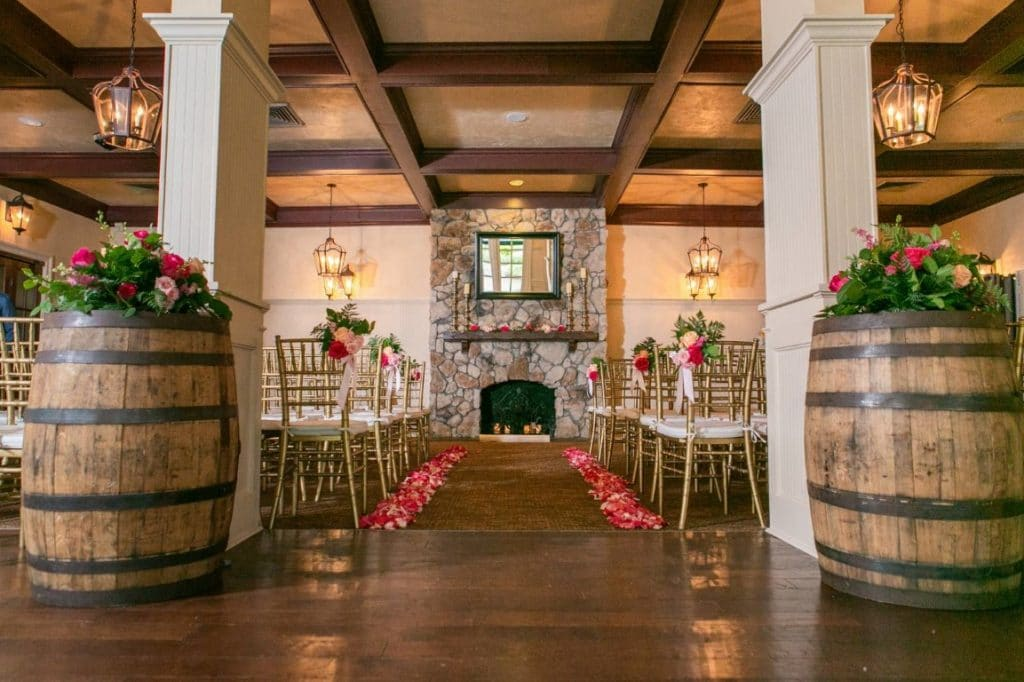 Historic-Dubsdread-Ballroom- Stone fireplace aisle with brightly colored flowers lining the walk way