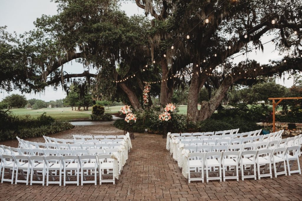 Historic-Dubsdread-Ballroom-Ceremony set up outdoors by trees with lights