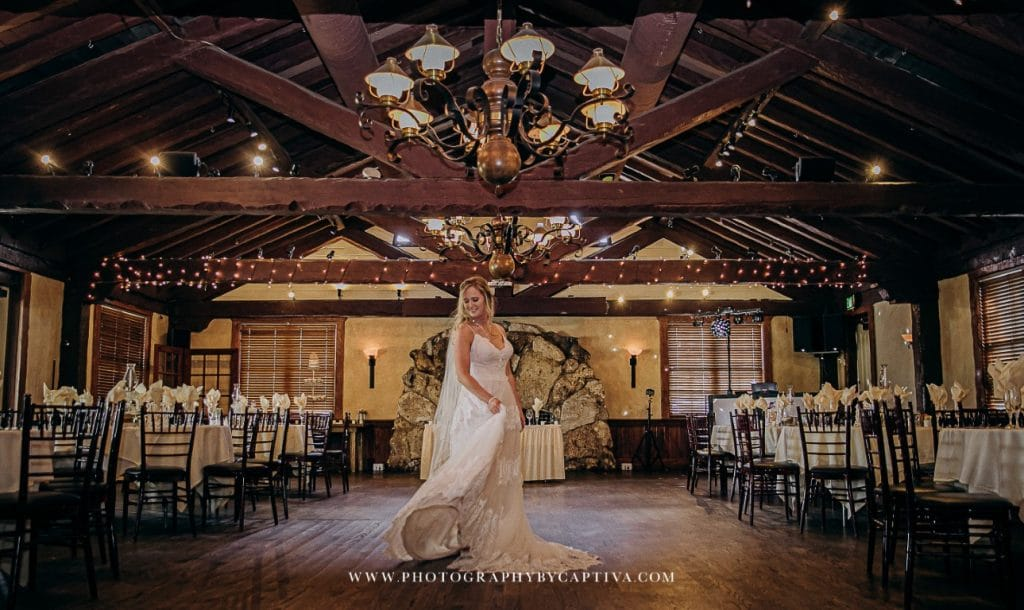 Historic-Dubsdread-Ballroom-Bride twirling in wedding dress in reception hall
