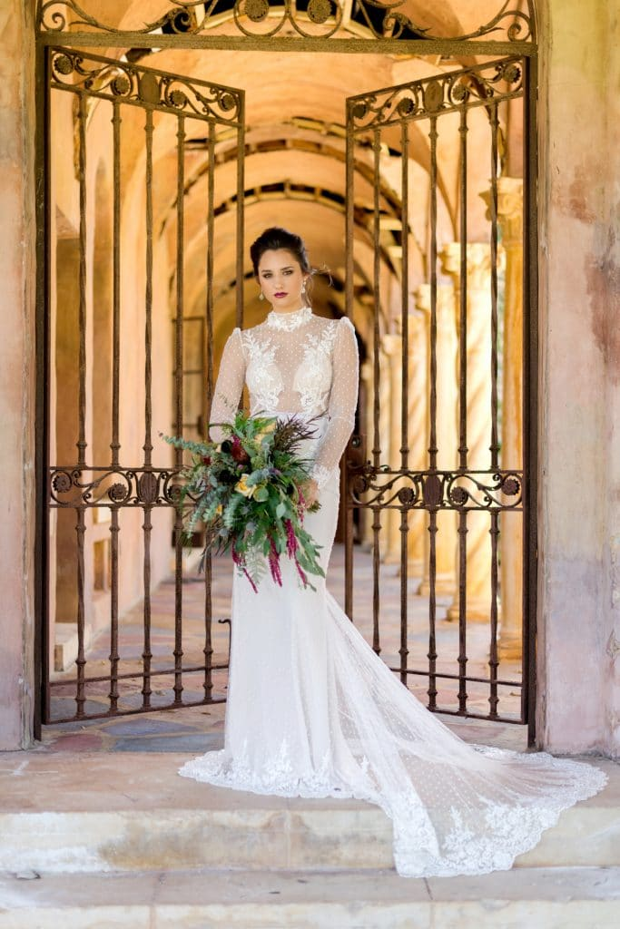 The Howey Mansion - bride in front of iron gate