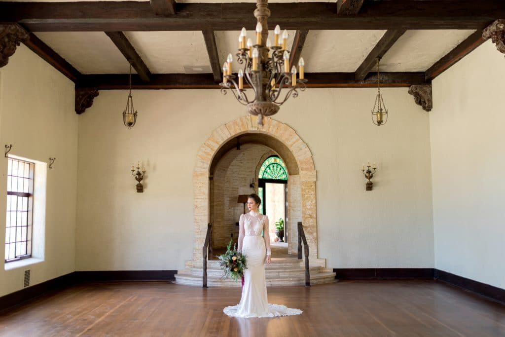 The Howey Mansion - bride in empty Spanish-revival room