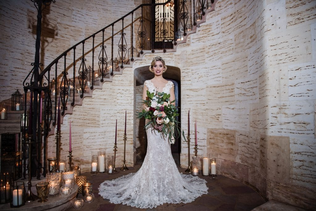 The Howey Mansion - lovely bride with curving staircase